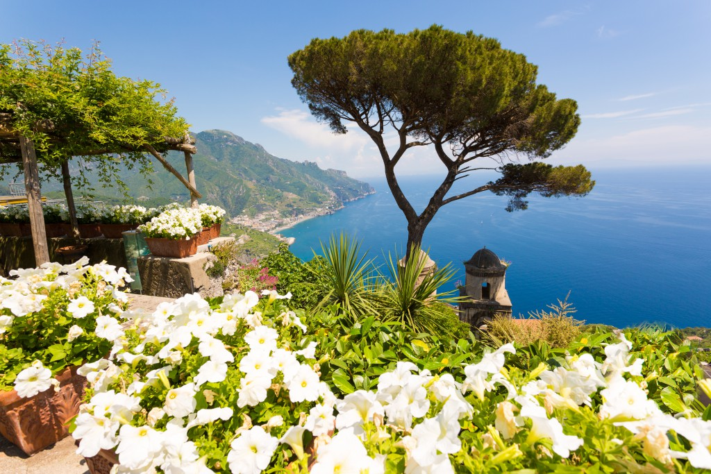 Ravello, Amalfi Coast, Salerno, Italy. Blue sky and sea with white flowers