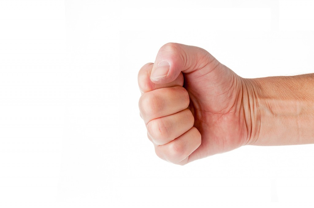 Fist closeup isolated on white background