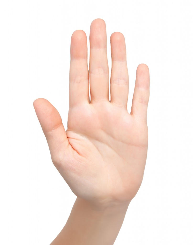 isolated female hand showing stop